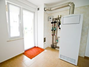 image of a heater within a utility room, venting outdoors