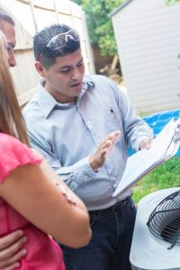 technician reviewing paperwork with homeowner