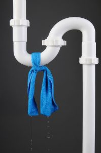 pipe-with-blue-cloth-tied-around-it