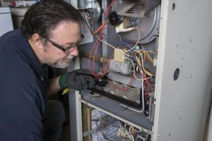 technician-inspecting-gas-furnace
