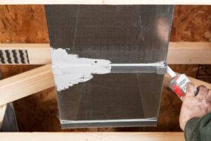 hand-applying-sealant-to-duct